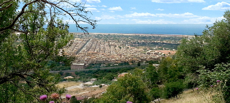 The town of Cinisi and the airport of palermo in the distance.
