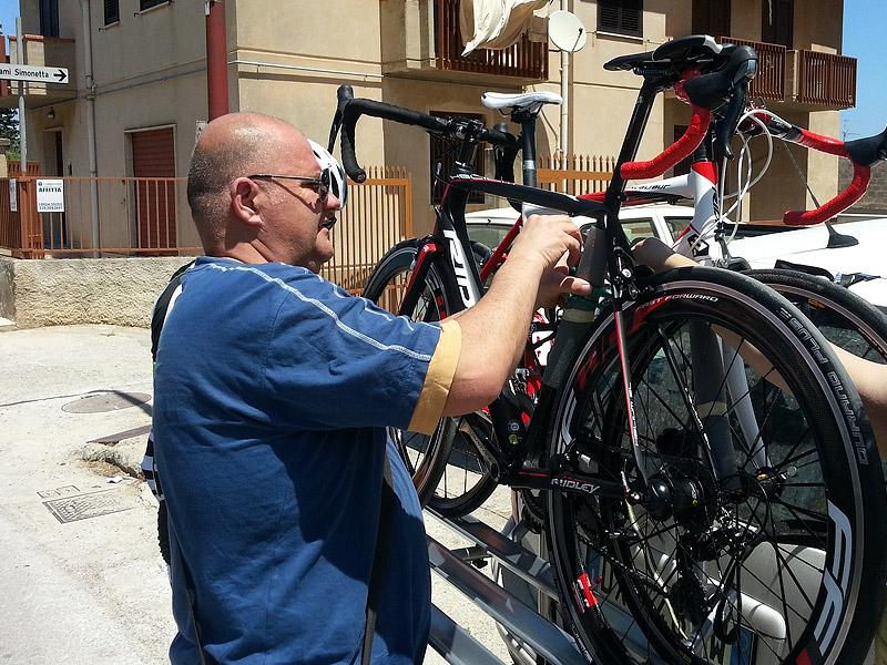 Giuseppe securing my bike on the bike rack