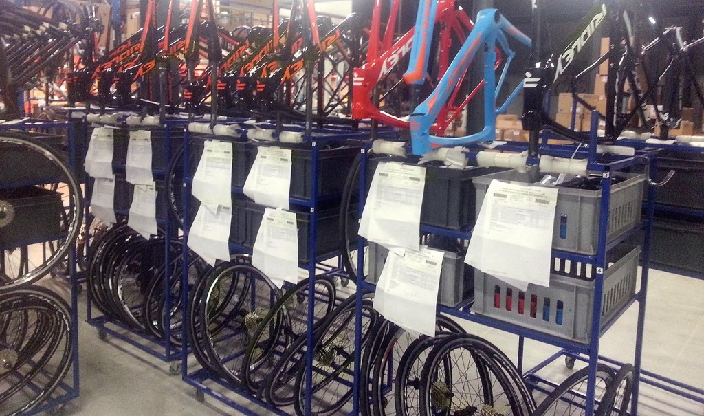 Frames and parts in carts ready to be assembled