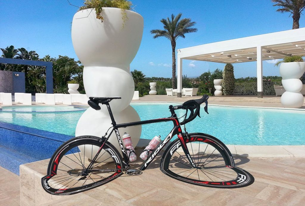 The two halves of the bike positioned on the background image